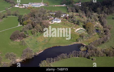 aerial view of a large private house with tennis courts fish pond lake near Congleton, Cheshire - Stock Image