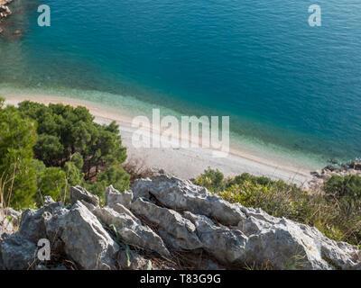 Paradise hidden beach Nugal on Adriatic sea coast in Croatia - Stock Image