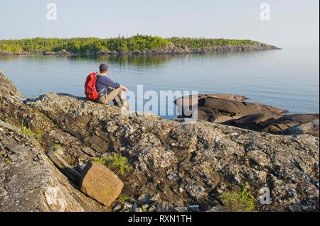 hiker, Pukaskwa National Park, Lake Superior, Ontario, Canada - Stock Image