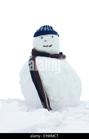Happy snowman with wooly hat and scarf. - Stock Image