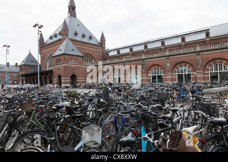 Bicycles at Copenhagen Railway Station - Stock Image