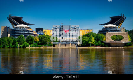 Heinz Field sits along the Allegheny and Ohio rivers on the North Shore of Pittsburgh, Pennsylvania, USA - Stock Image