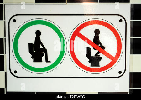 Cambodia, Kampong (Kompong) Cham, do not stand on toilet seat sign in Café toilets - Stock Image