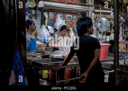 Muslin meat stall. Thailand backstreet indoor market. Southeast Asia - Stock Image