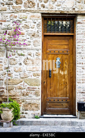 An old wooden door in a Turkish house - Stock Image