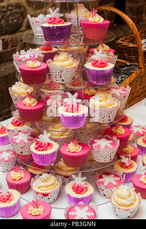 beautiful cupcakes on display stand - Stock Image