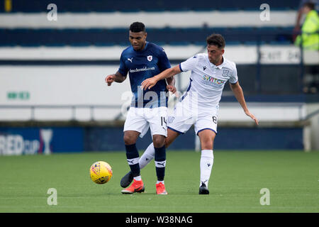 Starks Park, Kirkcaldy, UK. 13th July, 2019. Scottish League Cup football, Raith Rovers versus Dundee; Joao Victoria of Raith Rovers challenges for the ball with Shaun Byrne of Dundee Credit: Action Plus Sports/Alamy Live News - Stock Image