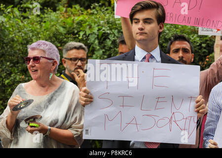 Regent's Park London, 12th July 2018. Demonstrators are protesting against US President Donald Trump's visit to London at Hanover Gate, close to Winfield House, the US ambassador's residence where Trump is expected to spend some time today. Pictured is a young counter-protester who says he welcomes Trump. Credit: Imageplotter News and Sports/Alamy Live News - Stock Image