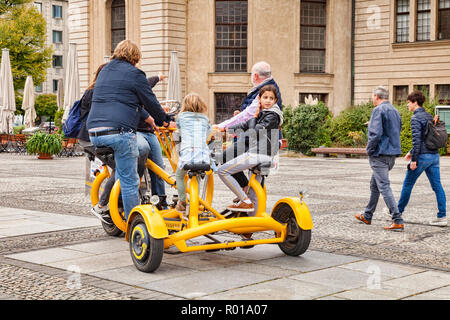 22 September 2018: Berlin, Germany - Family riding a Funbike in central Berlin, Germany. - Stock Image
