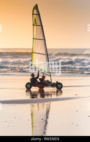 A father and young son on a sand yacht on Fistral in Newquay Cornwall. - Stock Image