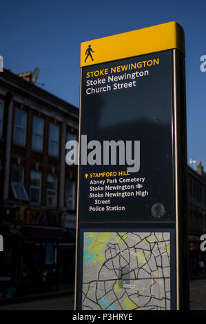 stoke newington church street hackney street map showing abney park cemetery and the police station with a blue sky and sunlight - Stock Image