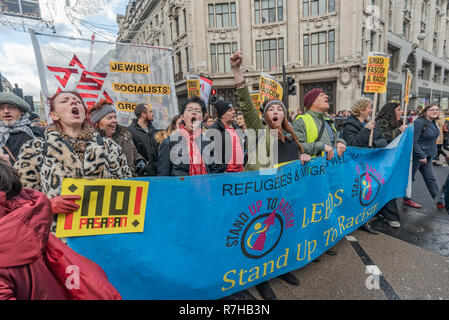 London, UK. 9th Dec, 2018. A united counter demonstration by anti-fascists marches in opposition to Tommy Robinson's fascist pro-Brexit march. The march which included both remain and leave supporting anti-fascists gathered at the BBC to to to a rally at Downing St. Police had issued conditions on both events designed to keep the two groups well apart. Credit: Peter Marshall/Alamy Live News - Stock Image