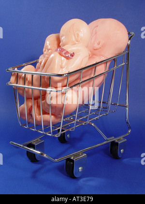 Embryo in the trolley as symbol for retort baby children on order main cell research artificial fertilization etc - Stock Image
