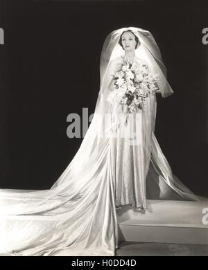 Bride wearing glittery wedding dress - Stock Image