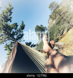 Chilling in a hammock - Stock Image