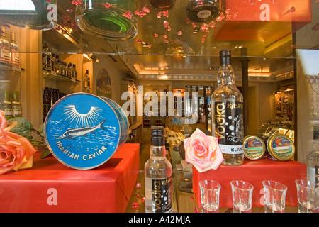 Paris France Place de la Madeleine Caviar house gourmet shop shop window with Caviar and wodka - Stock Image