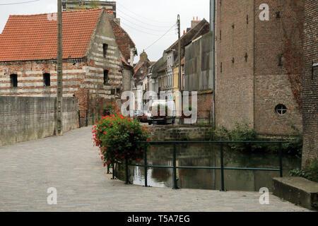 River flowing through Aire sur la Lys, Pas de Calais, Hauts de France, France - Stock Image