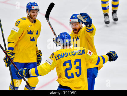 Bratislava, Slovakia. 18th May, 2019. From left hockey players of Sweden ALEXANDER WENNBERGER, OLIVER EKMAN-LARSSON, ADAM LARSSON celebrate a goal during the match Sweden against Switzerland within the 2019 IIHF World Championship in Bratislava, Slovakia, on May 18, 2019. Credit: Vit Simanek/CTK Photo/Alamy Live News - Stock Image