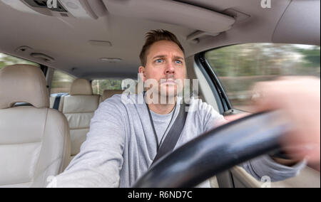 FLODA, SWEDEN - DECEMBER 4 2018: Mid adult caucasian man looking concentrated or worried when driving car - Stock Image
