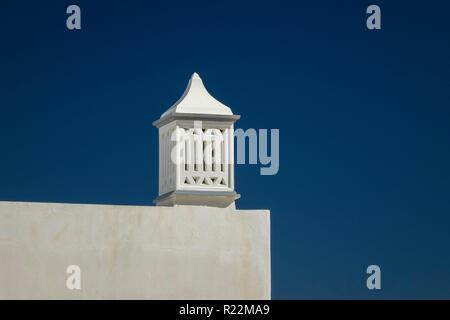 A Decorative White Chimney Cap Albufeira Portugal - Stock Image