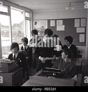 1965, schoolbiys and girls doing a typing class, England, UK. - Stock Image