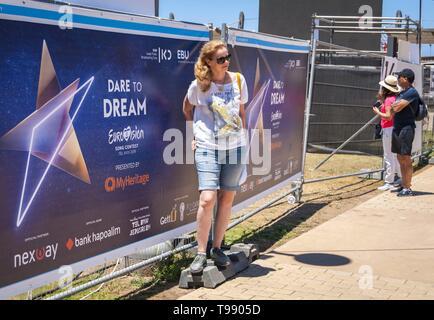 TEL AVIV, ISRAEL. May 11, 2019. People curious about the preparations to the Eurovision song contest in Tel Aviv and posing with a contest logo. - Stock Image