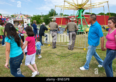 Police officers on duty at funfair in Texas, USA - Stock Image