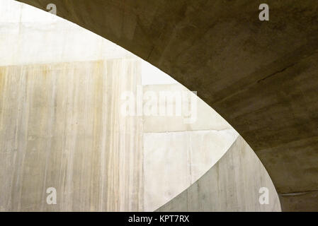 Toned brown shadows and lines of cement interior forming an architectural abstract pattern - Stock Image