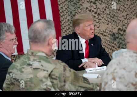 U.S. President Donald Trump meets with senior military leaders and answers questions from the media during a surprise visit to al-Asad Air Base December 26, 2018 in Al Anbar, Iraq. The president and the first lady spent about three hours on Boxing Day at Al Asad, located in western Iraq, their first trip to visit troops overseas since taking office. - Stock Image