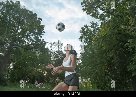 young woman practising football - Stock Image