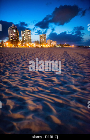 Coolangatta's beach and skyline at dusk. Sometimes paired as 'Twin Towns,' Coolangatta and Tweed Heads, - Stock Image