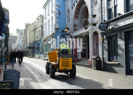 A small dumper truck driving through the town of Falmouth, Cornwall. - Stock Image