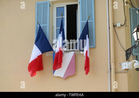 French Tricolor Flags On The Town Hall (La Mairie) Of Castellar In France, French riviera, Europe - Close Up View - Stock Image
