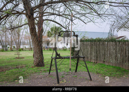 View of a 19th century bell used to summon slaves to work in pre-emancipation era Louisiana, Whitney Plantation Museum, USA - Stock Image