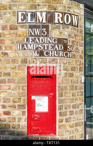 London, UK - October 20, 2018 - Traditional old English red postbox mounted in a brink wall in Hampstead - Stock Image