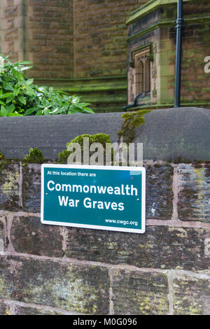 Commonwealth War Graves commission plaque on the churchyard wall of St Peters church, Woolton, Liverpool. - Stock Image