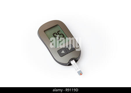 Glucometer with good blood sugar result isolated on white background - Stock Image