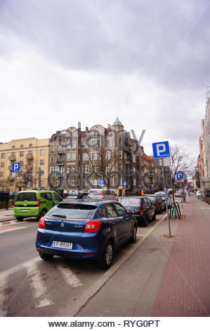 Poznan, Poland - March 8, 2019: Parked new blue Suzuki Baleno car on a non parking area on the Slowackiego street in the city center. - Stock Image