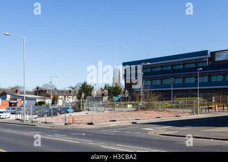 Demolition site safety notice on the cleared site of the former AJ Cafe, Albert Road, Farnworth. Building demolished - Stock Image
