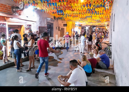 Cartagena Colombia Old Walled City Center centre Getsemani night nightlife Hispanic resident residents Calle San Andres Colombitalia arepa storefront - Stock Image