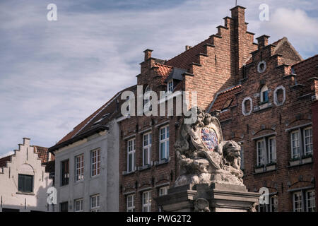 Monument with sculpture of Bruges coat of arms, Bruges, West Flanders, Belgium - Stock Image