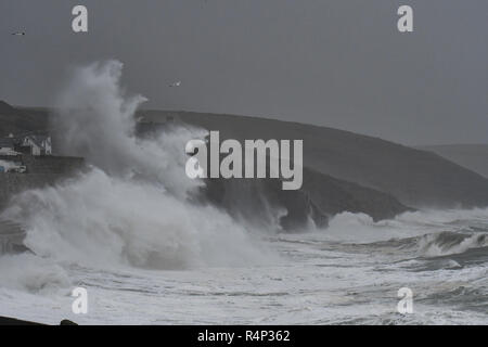 Porthleven, Cornwall, UK. 28th November 2018, UK Weather. With winds over 60mph huge waves are pounding the Cornish coast at Porthleven this morning as storm Diana hits the country Credit: Simon Maycock/Alamy Live News - Stock Image