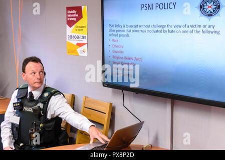 Belfast, Northern Ireland. 16/10/2016 - A police officer delivers a presentation on Hate crime awareness. - Stock Image