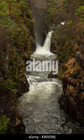 A waterfall plunges into a deep gorge on a mountainside at Torridon in the Scottish Highlands - Stock Image
