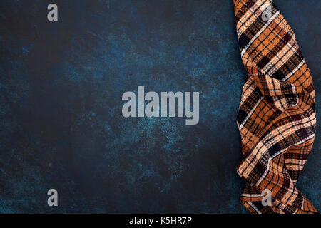 Blue concrete background (backdrop) with a napkin. view from above. Copy space - Stock Image