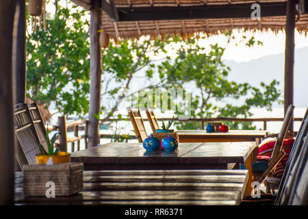 Open sided relaxed basic restaurant on sea side location. - Stock Image