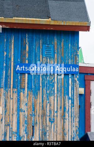 Greenland. Scoresby Sund. Ittoqqortoormiit. Street sign in Greenlandic. - Stock Image