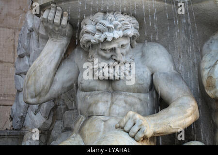 Muscular Triton supports the Danube Fountain in front of the Albertina Museum in Vienna, Austria. The Danube Fountain - Stock Image