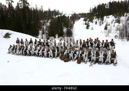 U.S. Marines assigned to The Combined Arms Company out of Bulgaria pause during training for a quick group photo. - Stock Image