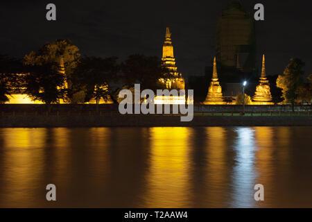 Chedis of Wat Phutthaisawan at night, Ayutthaya, Thailand. - Stock Image
